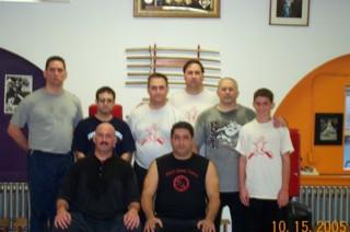 Sifu Bruce Nepon (seated left) with his Sifu, Master James Cama (seated right), with students at a recent seminar